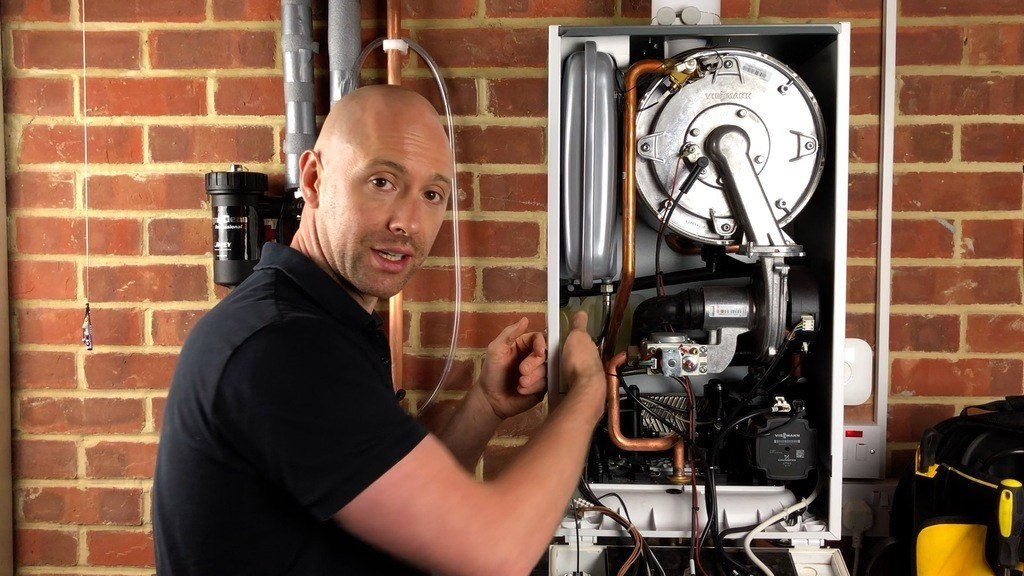 George the heating engineer working on a boiler
